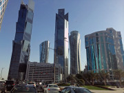 Doha Qatar Skyline driving Global High Performance visit to the Middle East