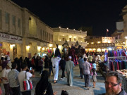 Souk Waqif stilt walkers crowd at night Doha Qatar Global High Performance visit to the Middle East