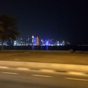 Doha Skyline at night driving Global High Performance visit to the Middle East
