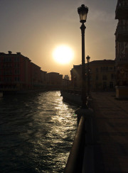 Sun setting Canal Pearl mall Doha Qatar Global High Performance visit to the Middle East