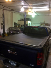 2014 GMC Sierra 1500 Bak industries Bakflip VP truck tonneau cover installation Global High Performance Rear view