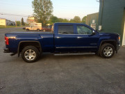 2014 GMC Sierra 1500 Bak industries Bakflip VP truck tonneau cover installation Global High Performance side view