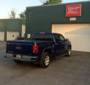 2014 GMC Sierra 1500 Bak industries Bakflip VP truck tonneau cover installation Global High Performance outside with GHP sign