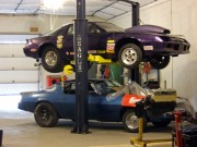 2 GHP drag racing camaros on the lift