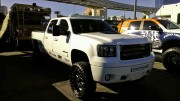 White lifted Chevy truck with light bars at SEMA 2012