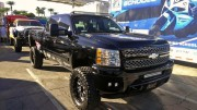 2012 Chevy truck lifted and LED lightbars at SEMA 2012 in black