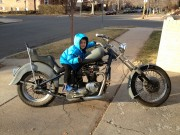 Max on Dad's 1966 slash 1969 Triumph Bonneville Chopper motorcycle
