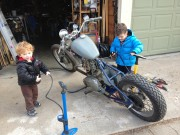 The boys helping Dad fix up his 69 Triumph Bonneville