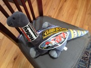 Stuffed dinosaur with ARH Holley Gibson and Airaid stickers, Sponsorship