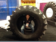 Jeremy Troggio goofing around inside tire SEMA 2014 GHP Global Hiogh Performance