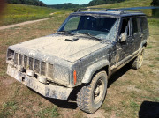 Moon Buggy Jeep Cherokee with bent bumper and missing headlight