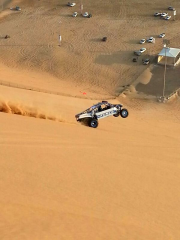 Sand rail Funco car top down wheelie at the Moreb Sand dunes Emirates U.A.E.